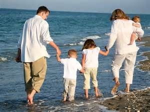Happy family wading in water: The 'r kids Family Center is licensed by the State of Connecticut, Department of Children and Families and offers a full range of adoption services.