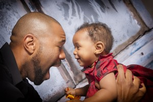 Father with daughter - help a family start over by donating items, time or money.